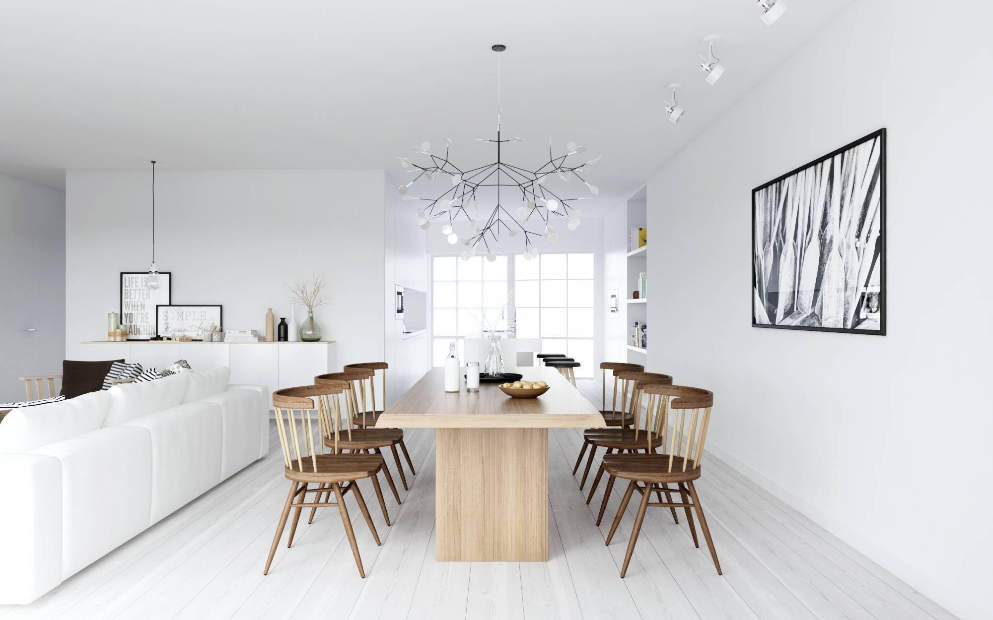 A madeira de tom claro junto ao ambiente de paredes e piso brancos com alguns contrastes em preto reforçam o estilo escandinavo.