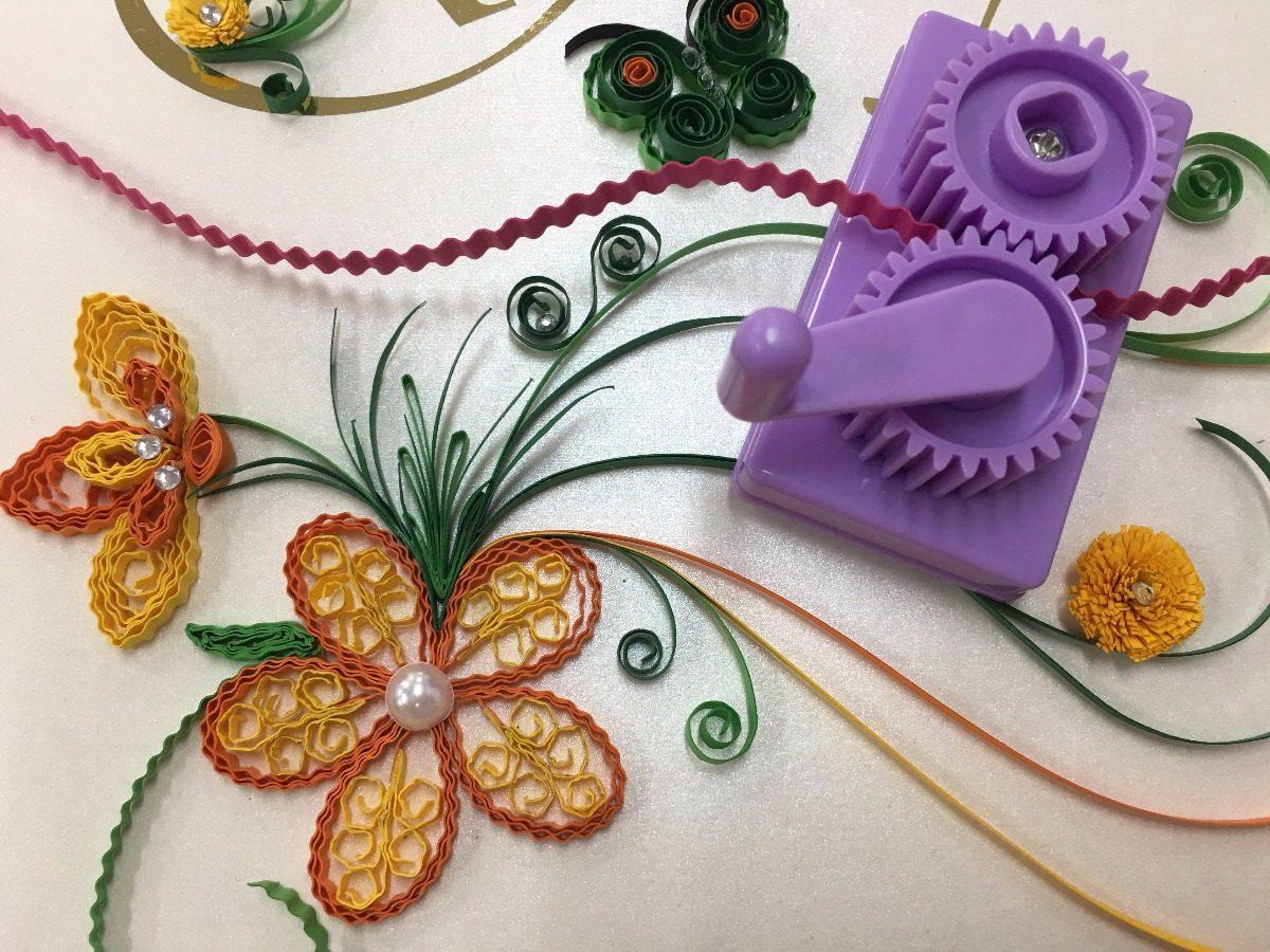 flores e réguas para ajudar a enrolar o papel para quilling
